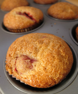 raspberry strawberry muffins baked in tin